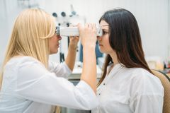 Eyesight test in optician cabinet, ophthalmology. Eyesight test in optician cabinet, diagnostic of vision, professional choice of glasses. Patient and doctor royalty free stock photography