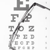 Eyesight test table with glasses over it - close up Stock Images
