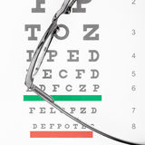 Eyesight test table with glasses over it - close up shot Royalty Free Stock Images