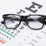 Eyesight test table and glasses over it - close up shot Stock Image