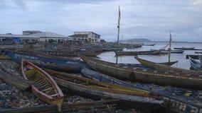 Eyesore shoreline pollution, Conakry Port. Wide span shot, fine cloudy evening , massive pollution, Conakry shoreline, spreading garbage, plastic litters stock video