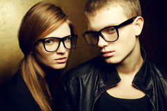 Eyewear concept. Gorgeous fashionable twins in glasses Stock Photos