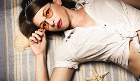 Eyewear fashion model. Pin up woman in sun shades Royalty Free Stock Image