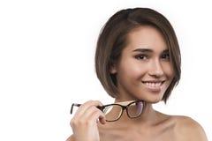 Eyewear glasses woman portrait isolated on white. Eyewear glasses asian caucasian mixwd race young big breast woman portrait isolated on white. Spectacle frame stock image