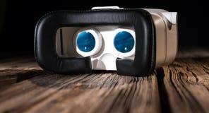 Eyewear innovative vr headset. White virtual reality glasses on old wood planks Stock Image