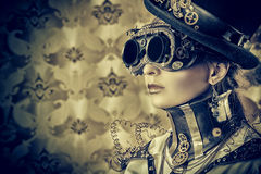 Eyewear. Portrait of a beautiful steampunk woman over vintage background Royalty Free Stock Image