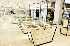Eyewear and sunglasses in optician store Royalty Free Stock Image