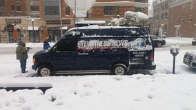 Eyewitnesses News in Snow Storm. News report in a snow storm Stock Images