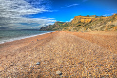 Eype pebble and shingle Dorset Jurassic coast in bright colourful HDR Stock Photo