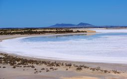 Eyre Peninsula Salt Lake. A salt lake with distant ancient mountains, inland Eyre Peninsula (Australia Stock Photo