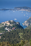 Eze hilltop village on the Cote d'Azur. The Provencal village of Eze on the French Riviera with Cap Ferrat in the background Royalty Free Stock Photos