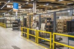 Fábrica de cadena de producción del tractor de Massey Fergusson en la planta de la maquinaria agrícola de AGCO imagenes de archivo