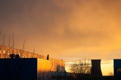 Fábrica en la puesta del sol Imágenes de archivo libres de regalías