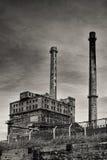 Fábrica velha com as chaminés no estilo retro Imagens de Stock Royalty Free