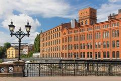 Fábricas viejas del ladrillo rojo. Paisaje industrial. Norrkoping. Suecia Imagen de archivo libre de regalías