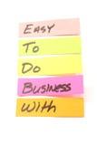 Fácil fazer o negócio com notas pegajosas Foto de Stock