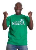 Fã de esportes Cheering de Nigéria fotografia de stock royalty free