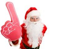 Fã de esportes Santa com dedo da espuma Fotografia de Stock Royalty Free