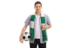 Fã de futebol novo com um lenço e um futebol Foto de Stock