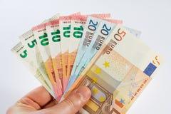 Fã do dinheiro em uma mão Foto de Stock Royalty Free