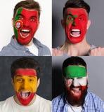 Fãs de futebol emocionais com as bandeiras pintadas nas caras Fotos de Stock