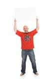 Fãs: Guy Holding Up Blank Sign imagem de stock royalty free