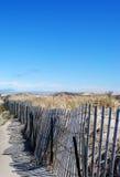 Fäktat i stranden Arkivfoto