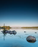 Fäll ned Buckhorn ståenden för sjösolnedgången Arkivfoto