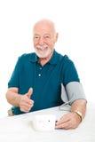 Fälla ned blodtryckframgång Arkivfoto