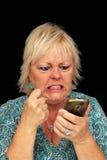 Fällige blonde Frau mit Handy (8) Stockbilder