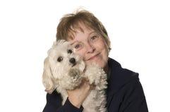 Fällige Frau mit ihrem Welpen Stockfotografie
