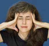 Fällige Frau mit Kopfschmerzen Lizenzfreie Stockbilder
