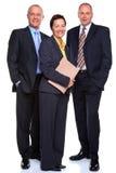 Fällige Geschäftsleute auf Weiß Stockbild