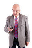 Fälliger Geschäftsmann am Telefon Lizenzfreie Stockfotos