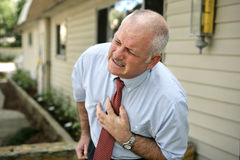 Fälliger Mann - Herzinfarkt Stockfotos