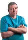 Fälliger Mann mit den Armen kreuzte, getrennt lizenzfreies stockbild
