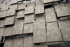 Fält av bruntfyrkantplattor med stentextur Arkivfoton