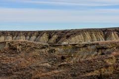 Fält av grässlättar med sceniska kanjoner lite varstans Arkivfoto