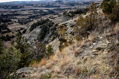 Fält av grässlättar med sceniska kanjoner lite varstans Arkivbilder