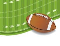 Fält för amerikansk fotboll och bollbakgrund Arkivfoto