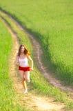 fält som kör kvinnan arkivfoton