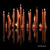 Färben sich Kerzen das Brennen, schmelzend, gefärbt gelb Auch im corel abgehobenen Betrag Stockbild