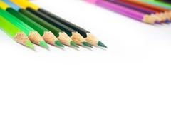 Färben Sie Bleistift auf einem Weißbuch für Hintergrund, Rahmen Stockfotografie