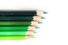 Färben Sie Bleistift auf einem Weißbuch für Hintergrund, Rahmen Lizenzfreies Stockbild