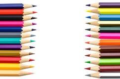 Färben Sie Bleistifte oben getrennt auf weißem Hintergrundabschluß Stockfotos
