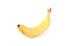 Färben Sie die Banane gelb, die auf dem Weiß getrennt wird Lizenzfreies Stockfoto
