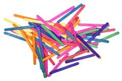 Färben Sie hölzerne Eiscremestockkunst und abstrakten Hintergrund lizenzfreies stockbild