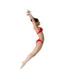 Färdig flicka i rött hoppa för bikini Fotografering för Bildbyråer