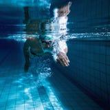 Färdig simmareutbildning vid honom Royaltyfria Foton