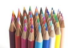 färga gruppblyertspennor plattforma upp Arkivfoto